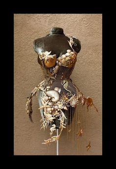 Steel Corset by FIORI Couture.  One of a kind gold brushed steel corset embellished with Glass Beads and Swarovski Crystals