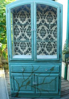 Teal bird cabinet. Not crazy about the birds but the rest of the cabinet is pretty neat.