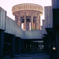 Debrecen, Hungary old water tower and empty marketplace in the sunset House In The Clouds, Kenzo Tange, Round Building, Brutalist Buildings, Alien Spaceship, Water Tower, Futuristic Architecture, Museum Of Modern Art, Water Tank