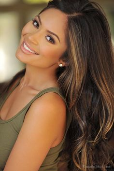 love the hair and makeup here. Dark brown hair with caramel,y highlights.