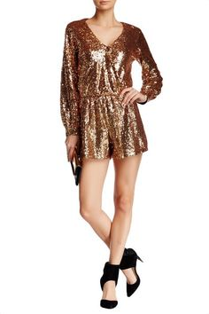 Bright gold sequins sparkle over this long sleeve romper with a surplice bodice that secures with a single snap at the deep V neckline. Made in USA FIT: This garment fits true to size. LENGTH: Above m