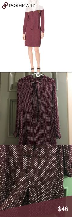 Michael Kors polka dot dress with tie neck Like new.  100% silk burgundy polka dot dress with tie neck and front slit.  Perfect for the office. MICHAEL Michael Kors Dresses Midi