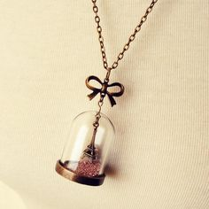 Eiffel Tower Snow Dome Necklace with Pink Glitter and Antique Bronze Bow on Etsy, $32.00
