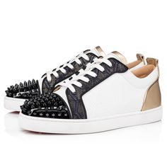 The Louis Junior Spikes Orlato low sneaker is an iconic Maison Christian Louboutin shoe and revisits the graphic codes of the tennis world. Set on a white rubber sole, its elegant upper is accentuated at the front by signature spikes. Its delicate finishes help contrast the patent leather with its avant-garde Art Deco fabric and arrow embossed leather. Leather Men, Patent Leather, Art Deco Fabric, Red Sole, Christian Louboutin Shoes, Spikes, Online Boutiques, Arrow, Casual Shoes