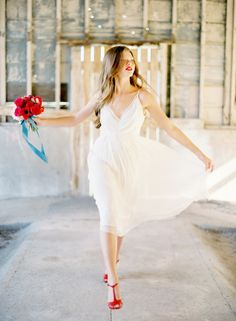 Love this look for a subtle red, white & blue wedding theme! Red shoes and Saja Wedding dress | Jose Villa