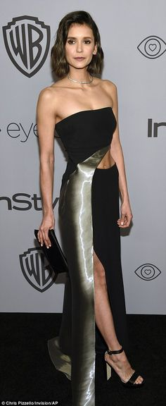 Head turners: Vampire Diaries beauty Nina Dobrev looked sensational in a cut-out gown with...