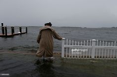 Doug LeFever inspects the seawall near his home at the Sandpiper Resort as he surveys the rising water coming from the Gulf of Mexico into his neighborhood as winds and storm surge associated with Tropical Storm Hermine impact the area on September 1, 2016 at in Holmes Beach, Florida. Hurricane warnings have been issued for parts of Florida's Gulf Coast as Hermine is expected to make landfall as a Category 1 hurricane