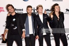 Singers Louis Tomlinson, Liam Payne, Niall Horan, and Harry Styles of One Direction, winners of the Top Duo/Group and Top Touring Artist awards, pose in the press room during the 2015 Billboard Music Awards at MGM Grand Garden Arena on May 17, 2015 in Las Vegas, Nevada.
