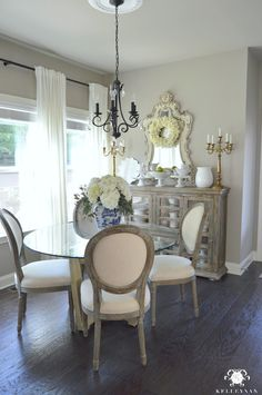 Kelley Nan: Summer Home Showcase - French Country Breakfast Dining Room with World Market Paige Round Back Chairs, Dark Hardwood Floors, Ikea Ritva Panels, White hydrangeas in blue and white ginger jar