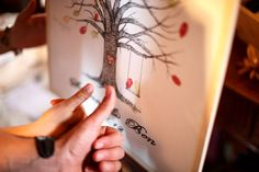 Fingerprint tree guest book... the couple's prints are in the swing on the tree... cute!