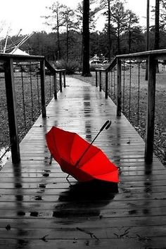 Red umbrella, like the cover of BREAKING THE BANK.