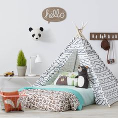 Love the animal head, the hello, kinda rethinking the cool bed in favor of this camping style bed