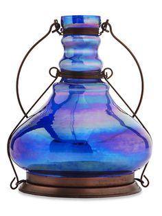$15, Pier 1    Made of lustrous blue glass, this genie bottle-like lattern (7 1/2 inches tall) will make any event more magical