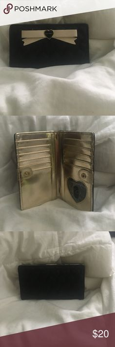 Betsey Johnson wallet Betsey Johnson wallet. Never used. Black outside with heart detail. Cream bow on front. Inside gold colored. Betsey Johnson Bags Wallets