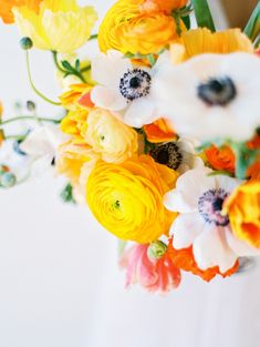 Marigold Ranunculus and Anemone Centerpiece   photography by http://lovebyserena.com/