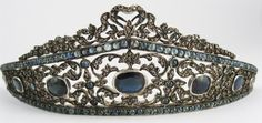 This early 19th-Century silver gilt, diamond, and sapphire tiara sold on eBay for $ 3000 on Sept 19, 2011. It is set with 7-10 carats of natural cabochon sapphires, 3-5 carats of table cut diamonds, and nine large sapphires with a total weight of 15-20 carats.