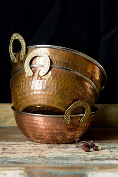 Copper bowls from India. Copper is seen as a beneficial element in Indian cuisine, part of the ancient medical system of India, known as Ayurveda