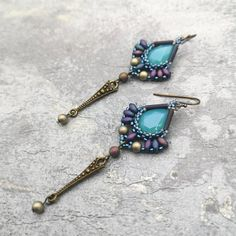 Long teardrop earrings with transparent opalescent glass rhinestones. Very light and elegant! Materials: - Glass rhinestones - Japanese seed beads - Czech glass beads - Findings in antique brass color  Measurements: Width 1 (2.5cm) Length 3 (7.5cm) ___________________________________________________