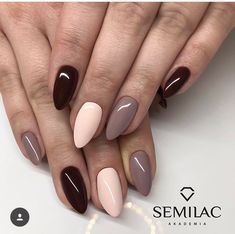 Black, light pink, and light brown short almond nails