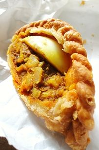 Curry Puffs | 27 Reasons Singapore Is The Most Delicious Place On Earth  WHAT THEY ARE: The country's most popular street food, curry puffs are to Singapore what hot dogs and jumbo pretzels are to New York City. The traditional curry puff is a chicken and potato mixture coated in a mild, tumeric-based curry paste, wrapped in a thick, savory pastry crust, then baked or fried.