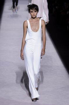 See all the Tom Ford Spring 2018 looks from the runway. (Spoiler: big shoulders are back!)