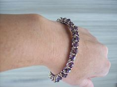 These beaded bangles can be worn as a single or layered for a more dramatic affect. They are comfortable and easily fit the average 7-1/2 wrist.