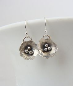 Hand forged sterling silver flower earrings by JewelryByLyndsey, $45.00