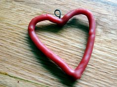 beeswax heart ornaments - pipecleaners shaped into hearts then dipped into red beeswax. Love it!!