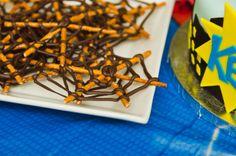 Spiderman Birthday Party. Pretzel and chocolate webs.
