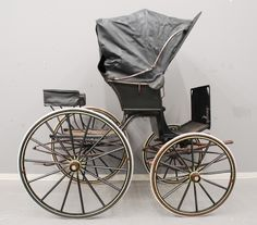 A phaeton was a four-wheeled vehicle that seated two, one of whom drove the horses pulling it.