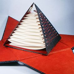 Black Pyramid Book;  http://vi.sualize.us/black_book_deckled_edge_bindery_pyramids_picture_hXhr.html: