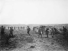 Canadian soldiers advance at the Battle of Vimy Ridge, 9–12 April 1917. [AWM A02855]