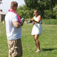 Make your gender reveal a spectator sport! Simply dress in white and fill squirt guns with either pink or blue dyed water. Take aim and reveal the gender!