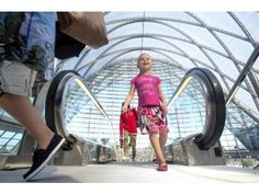 Five-year-old Delaney Gabriel heads for a train to San Diego at the $185.2 million station, the Anaheim Regional Transportation Intermodal Center, ARTIC opened Saturday to Metrolink, Amtrak, buses, and taxis.