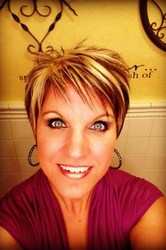 Choppy razor cut short hair cut....and love, love, love the color.