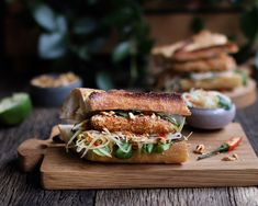 Crispy & Spicy Tofu Bánh Mì with Green Papaya Slaw. Very easy to make and vegetarian.  The tofu is coated in a sambal marinade, and then coated in panko to seal in all the flavours. Served as a sandwich with a nice baguette and green papaya slaw.