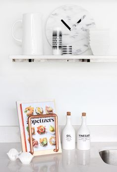 The all white styling around this DIY Cookbook Stand makes the copper pop beautifully!
