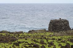 Rapa Nui / Easter Island / Isla de Pascua. Hanga O'Teo, on the northeast coast. Stone tower or tupa. Rapa Nui archaeology (32). Photo: Mike Seager Thomas, UCL Rapa Nui Landscapes of Construction Project. You are welcome to use/ circulate the photo but please credit it to the project