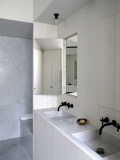 Concealed mirrors offering a more dynamic way of reflecting yourself and your surrounds. Design by Vincent Van Duysen.