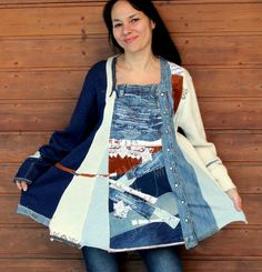 Reserved for Bonnie, do not purchase this item.  Art boro recycled denim jeans and sweater top. Made from recycled sweaters, denim jeans and shirts. Remade, reused, upcycled. Patchwork appliqued. Boro inspired. Hippie boho style. One of a kind.  Size: L (european 40)  Bust line max 43 inches (110 cm)  Hips line max 48 inches (122 cm)  Length about 31 inches (79 cm)  Wash separately in cool water (blue jeans)