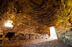 Inside a beehive hut at the 6th Century Irish  Monastery of Inishmurry, County Sligo, Ireland
