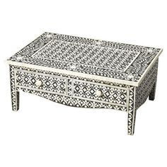 Bring an ornate touch to your entryway or master suite with this eye-catching coffee table, showcasing a bone-inlaid floral motif and curved apron.    ...