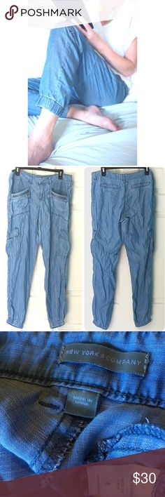 """Chambray Joggers Cargo Pants 8 Blue So light weight and soft, you'll want to live in them! The only flaw is that the inside button is missing, easy fix. Zip and 2 clips closure in front. Belt loops. 2 slide in & 2 zipper pockets in front. Snap cargo pockets 1 on side of each leg. 2 flat faux pockets in back for flattering look. Waist 16"""" across. Rise 9"""", inseam 30"""". Excellent! NOTE: Photos 2-3 are actual pants. Additional photos provided for styling inspiration! New York & Company Pants…"""