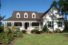 A great big wrap-around porch gives this country home plan a magnificent place to relax outdoors. The deeper portion in back is vaulted and is large enough to make a comfortable outdoor living room. The wrap-around porch is 8 Southern House Plans, Country House Plans, Best House Plans, Country Living, Southern Country Homes, Southern Farmhouse, Country Porches, Bedroom Country, Big Country