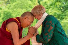 His Holiness the Dalai Lama thanking Green Party member Claudia Roth for her support at Wiesbaden Kupark in Wiesbaden, Hessen, Germany on July 12, 2015. Photo/Manuel Bauer