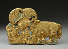 Belt Plaque (left) with Scenes of Tearing at Animals. Epoch. Period: Early Iron Age. Date: Sakae Culture. 6th century bc. Place of finding: Siberian collection of Peter I. Archaeological site: Russia, Siberia. Material: gold and turquoise.