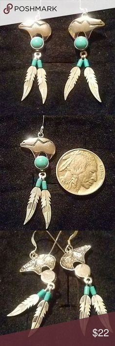 Navajo Turquoise bear and feather earrings These super cute turquoise bear and feather earrings are sterling silver will pair up nicely with lots of items in my closet bundle 3 items or more for 15% off Jewelry Earrings