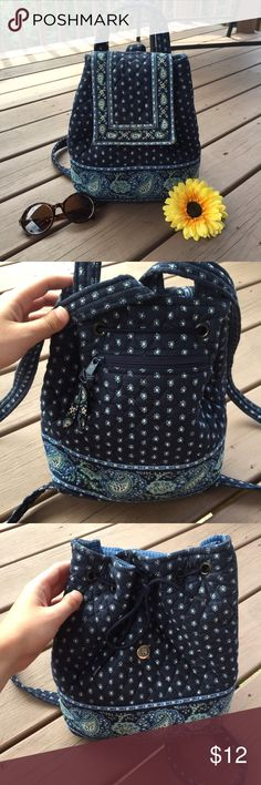 Retired Vera Bradley Mini bookbag So cute and small but can fit so many items! Perfect for any day on the town or even a hike! Only flaw is missing one of the round silver pieces around the string Vera Bradley Bags Backpacks