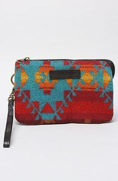 "Pendleton The Three Pocket Keeper in Red Multi by Pendleton. $38.00. Manufactured by Pendleton.. A brand-new, unused, and unworn item (including handmade items) in the original packaging (such as the original box or bag) and/or with the original tags attached.. Pendleton The Three Pocket Keeper in Red Multi. Allover printed wristlet with zip closure; applique logo on front; 3 interior pockets, 1 with zip closure; 100% wool body, 100% polyester lining. 4.75"" H x 7.5"" W x 2""..."