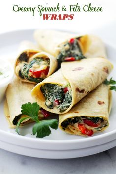 Creamy Spinach and Feta Cheese Tortilla Wraps - A deliciously creamy mixture of cheeses, peppers, spinach and feta wrapped in a flour tortilla.